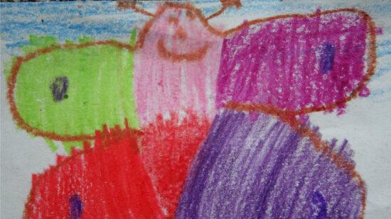 Ein gemalter bunter lachender Schmetterling